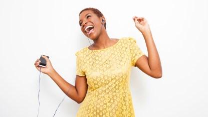 mature woman dancing listening to music