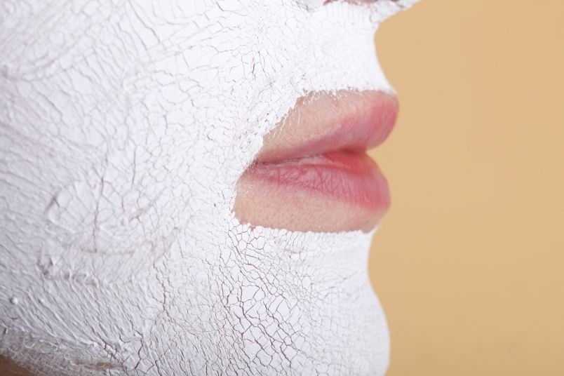 Mature woman with facial beauty mask