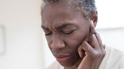 Woman feeling discomfort in her ears