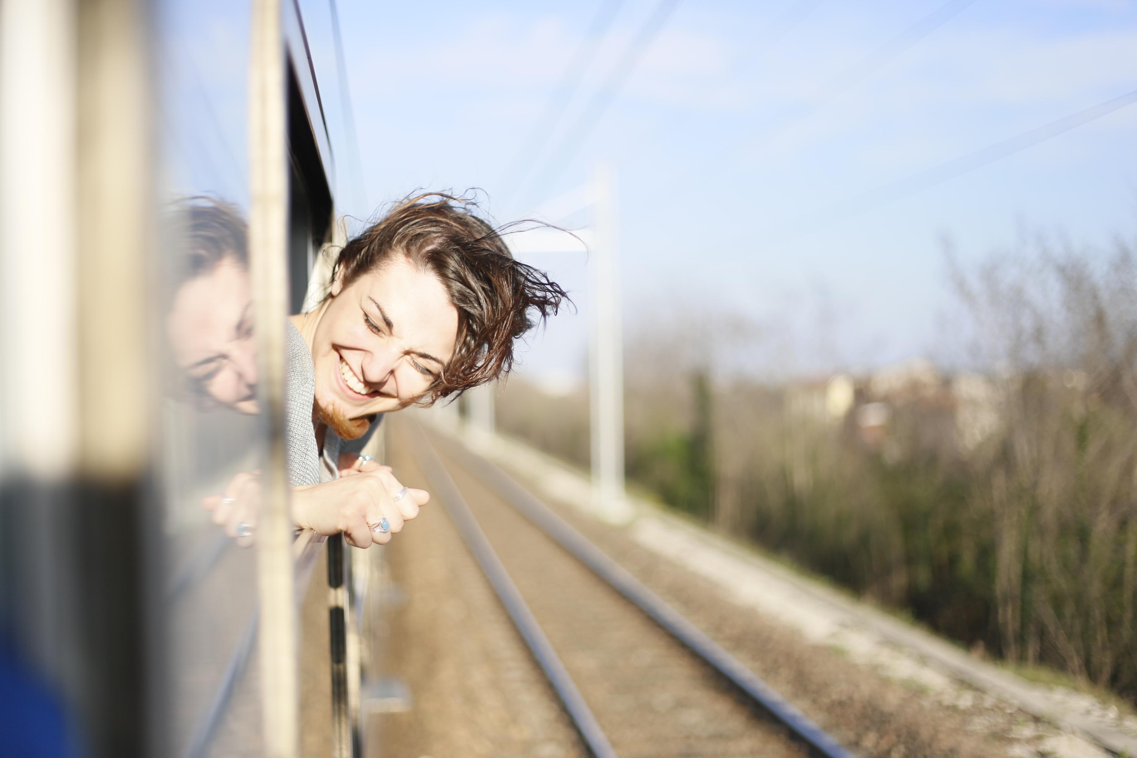 happy woman train