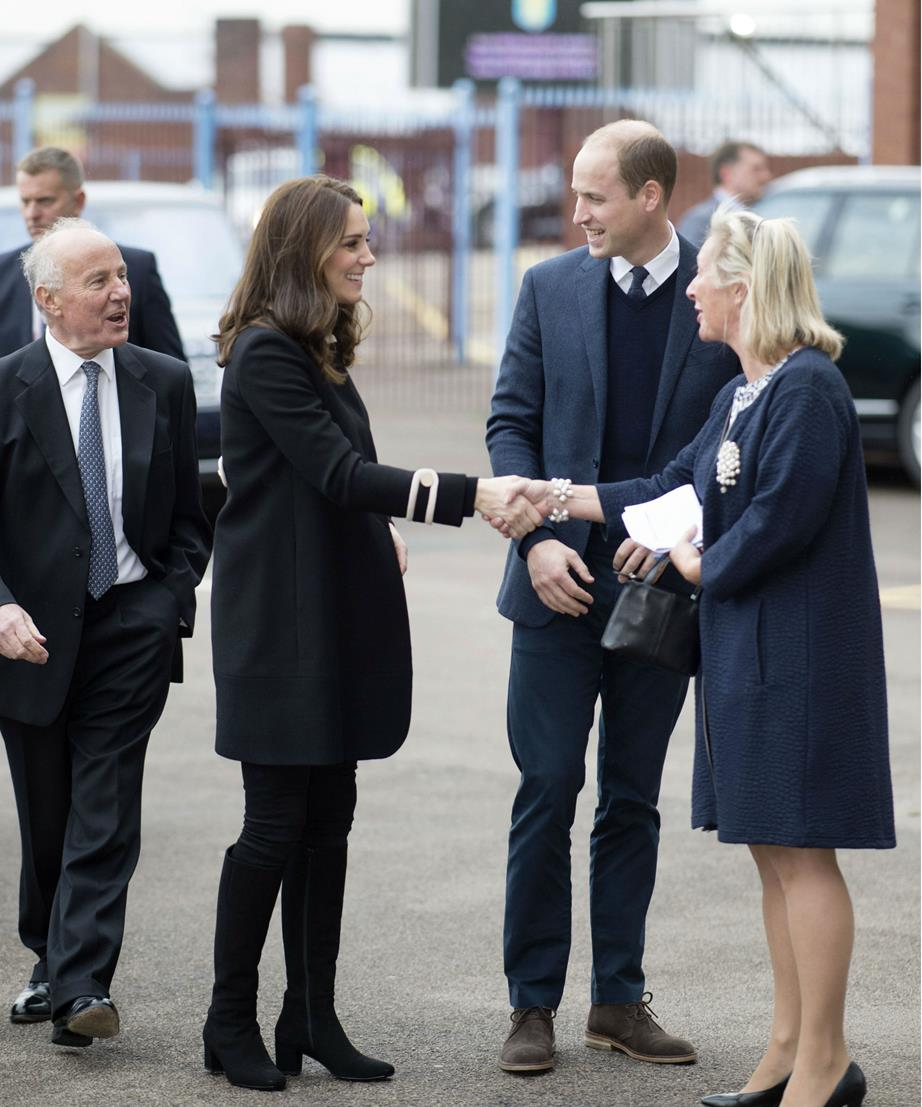 kate blue dress shaking hands