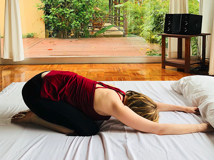 Try Bed Yoga for Pain and Better Sleep