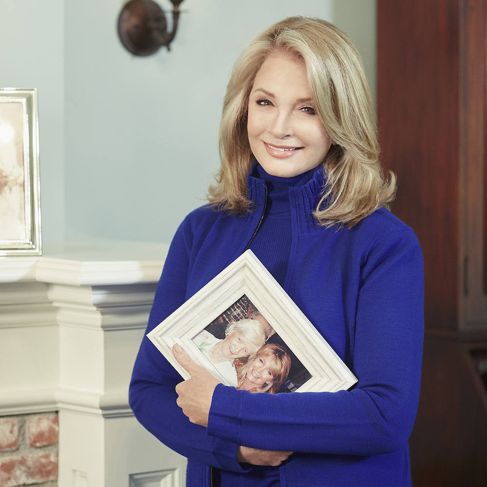 Deidre Hall with photo of mom